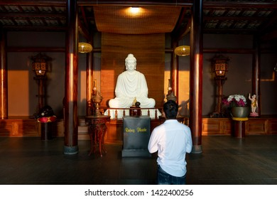 "Temple ""Linh Qui Phap An"", Bao Loc, Lam Dong province, Vietnam - Jun 2, 2019: The young boy was sitting in Linh Quy Phap An pagoda. He was praying at the temple ""Linh Qui Phap An"" in Bao Loc, Lam Dong"