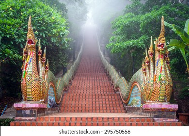 Temple Naga Stairway at  Doi Suthep Temple in the mist at morning , Chiang mai, Thailand