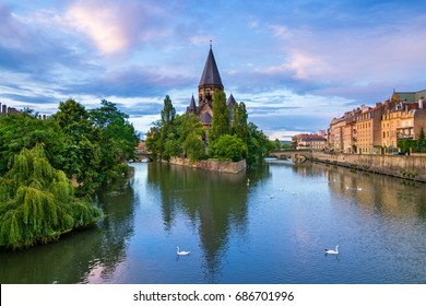 The Temple Neuf on the river Moselle in Metz, France. The iconic Protestant church  was built from 1901 to 1904 in grey sandstone and in Romanesque Revival style.