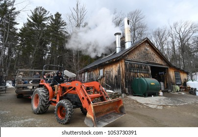 Temple, N.H./USA - March 24, 2018: Tourists take a wagon ride at Ben's Sugar Shack on New Hampshire Maple Weekend. To attract customers, syrup producers open their doors to visitors on Maple Weekend.