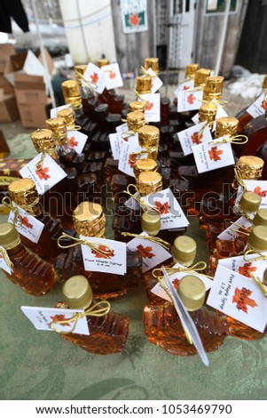 Temple, N.H./USA -- March 24, 2018. Glass bottles of maple syrup for sale at Ben's Sugar Shack on New Hampshire Maple Weekend.