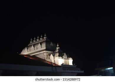Temple in night focused through light