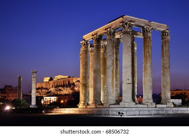 """The Temple of Olympian Zeus (considered one of the biggest of the ancient world) in the """"blue"""" hour, with Acropolis in the background"""