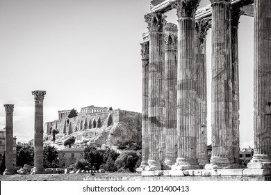 Temple of Olympian Zeus overlooking the famous Acropolis, Athens, Greece. Great Temple of Zeus or Olympieion is one of the main landmarks of Athens. Ancient Greek ruins of Athens in black and white.