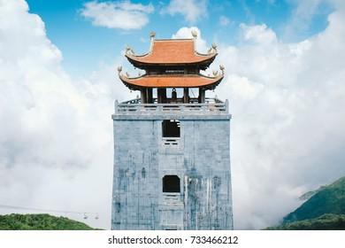 Temple on the mountain in blue sky Fansipan Legend, Vietnam