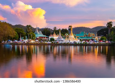 Temple and pagoda with beautiful light of yearly festival on sunset and have  reflect on lake.