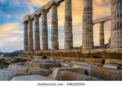 Temple of Poseidon at Cape Sounion, Attica - Greece. One of the Twelve Olympian Gods in ancient Greek religion and myth. He was god of the sea, other waters and of earthquakes. Sunset with cloudy sky