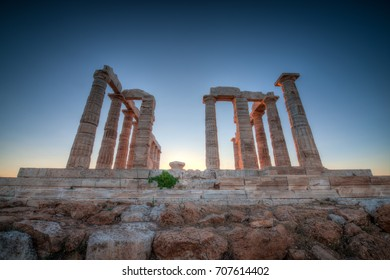 The Temple of Poseidon in the Cape of Suonion, Greece at dusk on a clear Summer day.