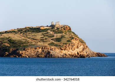 The Temple of Poseidon at Sounio, Greece against a cloudy sky, shot taken from accross the bay