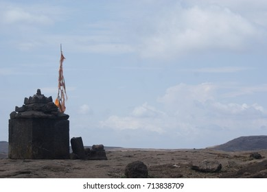 Temple With Safron and Sky at Harishchandragad