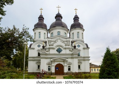 Temple of St. Peter Kalnyshevsky in Nedryhailiv, Sumska oblast, Ukraine. Beautiful white building with domes for religious purposes, Orthodox Church.