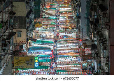 Temple Street, Hong Kong - JULY 4, 2017: Busy Traditional Stall Market in Temple Street of Hong Kong