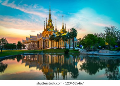 temple thailand / beautiful thailand temple dramatic colorful sky twilight sunset shadow on water reflection - Landmark Nakhon Ratchasima province temple at Wat None Kum in Thailand