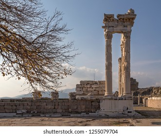 Temple of Trajan in the ancient city of Pergamon with autumn tree branches at sunset, Bergama, Turkey