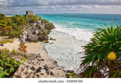 Temple of the Wind God from the Mayan ruins in Tulum, Mexico. The ruins were built on tall cliffs on the Caribbean Sea. Tulum was one of the last cities built and inhabited by the Maya.