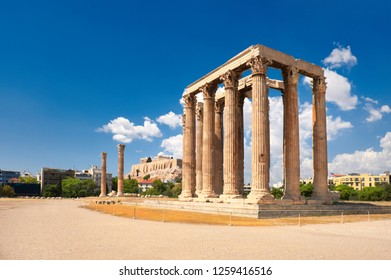 Temple of Zeus with Acropolis on the background in Athens, Greece on a bright day
