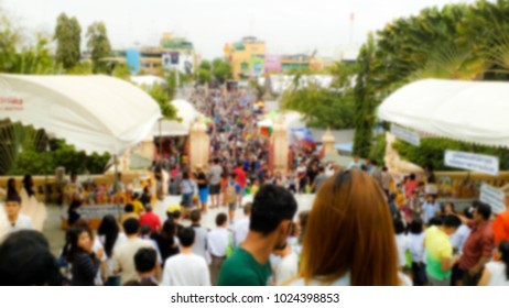 The temple's fair is held on special days, there are many shops, day and night. Abstract image blur