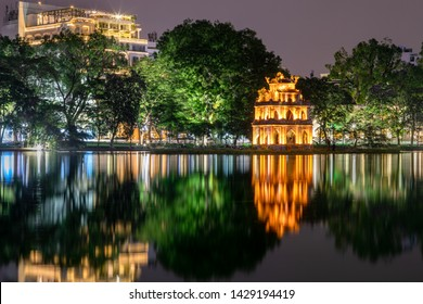 Temples in Hoan Kiem Lake in Vietnam at night. Temple of the jade mountain and Turtle tower are main landmark of Hanoi, Vietnam.