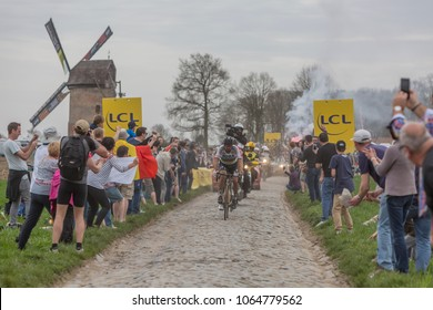 Templeuve, France - April 08, 2018: The road cycling world champion, Peter Sagan leading the race on the cobbled road in Templeuve in front of the traditional Vertain windmill during Paris-Roubaix