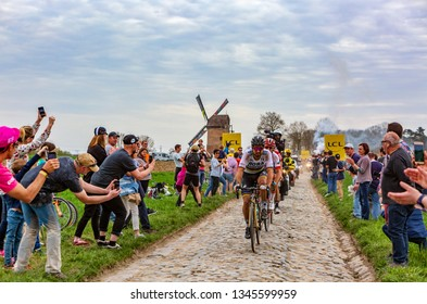 Templeuve, France - April 08, 2018: The triple road cycling world champion, Peter Sagan, leading the race on the cobblestone road in Templeuve during Paris-Roubaix 2018