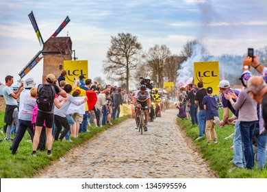 Templeuve, France - April 08, 2018: The triple road cycling world champion, Peter Sagan of Bora-Hansgrohe Team, leading the race on the cobblestone road in Templeuve during Paris-Roubaix 2018