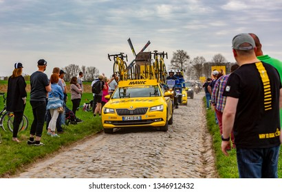 Templeuve, France - April 08, 2018: The technical car of Mavic driving on the cobblestone road in Templeuve during Paris-Roubaix 2018.