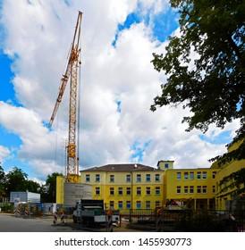 Templin, Brandenburg district Uckermark / Germany - July 17, 2019: The yellow crane at his work at Sana Hospital Templin