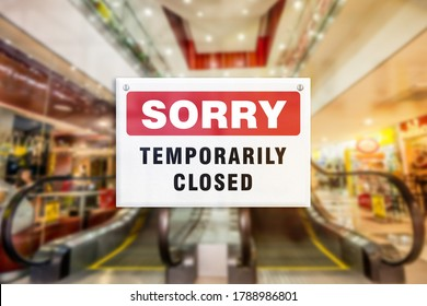 A temporary closure sign of a shopping mall. Concept of Closure, suspension, or bankruptcy of shopping center. Blurred escalator. - Shutterstock ID 1788986801
