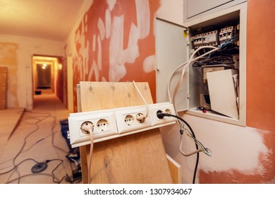 Temporary  electrical outlets for constructions tools   in apartment is inder construction, remodeling, renovation, overhaul, extension, restoration and reconstruction. Concept of home improvement.