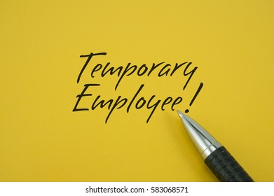 Temporary Employee! note with pen on yellow background