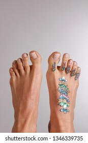 temporary foot tattoo, sticker, bare feet of a white woman,  studio shot