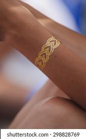 Temporary Metallic Flash Tattoo Bracelet on Woman's Arm