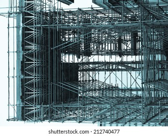 Temporary scaffold for construction works at building site - cool cyanotype
