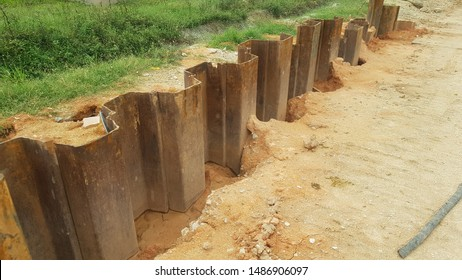 Temporary sheet pile cofferdam wall at the construction site in Malaysia. It is installed to allow soil excavation.