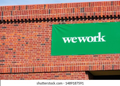 Temporary WeWork sign on new office shared coworking space building located in Silicon Valley. The startup We Company is headquartered in New York City - Palo Alto, California, USA - August 27, 2019