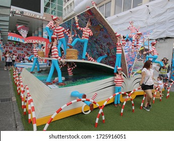 Temporary Where's Wally exhibition with a large book outside the Harbour City Mall. Hong Kong - 9th August 2015