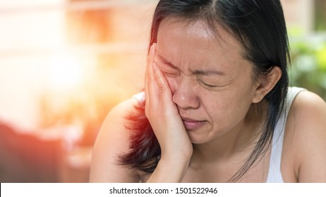 Temporomandibular Joint and Muscle Disorder: TMD concept. Woman hand on cheek face as suffering from facial pain or toothache