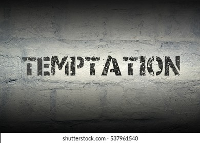 temptation stencil print on the grunge white brick wall