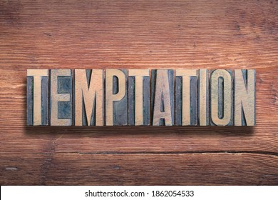 temptation word combined on vintage varnished wooden surface