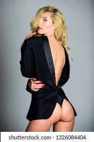 Tempting horny woman with jacket wearing on naked body. Lady boss sex game. Feeling so sexy. Booty sexy fashion lady. Girl sexy blonde wear formal jacket backwards. Woman sexy buttocks playful mood.