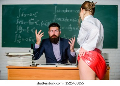 Tempting and seductive. Seductive woman seducting man in school. Sexy student in seductive red skirt. Using seduction tactics in class. Sexi woman with seductive look tease bearded man.