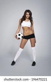 Tempting sexy female soccer fan with ball