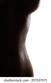 Tempting wet silhouette of an erotic asian woman with wet breast and waist isolated over white background.