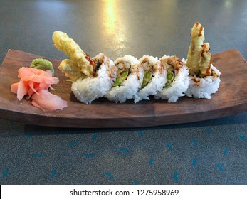 tempura asparagus sushi roll on wooden dish