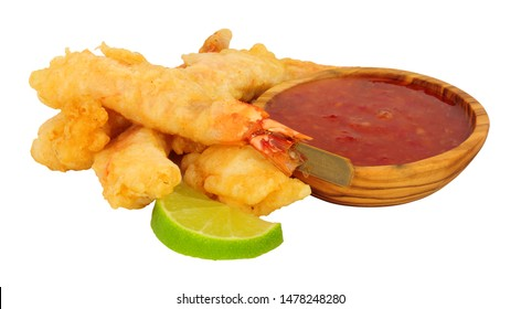 Tempura battered king tiger prawns on wooden skewers with chilli sauce dip isolated on a white background