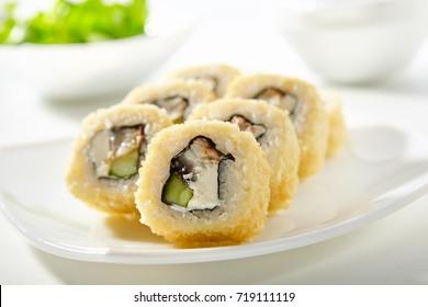 Tempura Maki Sushi - Deep Fried Roll made of Avocado  and Smoked Eel inside