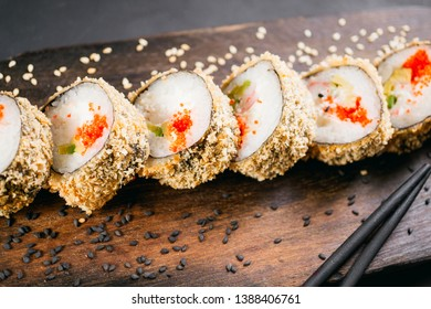 Tempura maki sushi roll on wooden platter. Japanese traditional fusion food style, restaurant menu