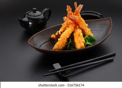 Tempura shrimp on a black plate