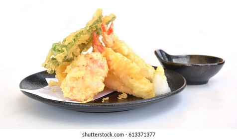 Tempura shrimps and vegetables with soy sauce, deep fried shrimps isolated on white background