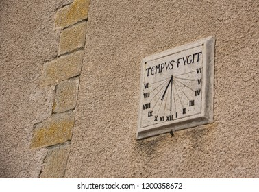 tempus fugit - a sun dial on an old wall in Southern France